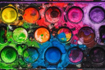 Black watercolor palette with mixed bright colors